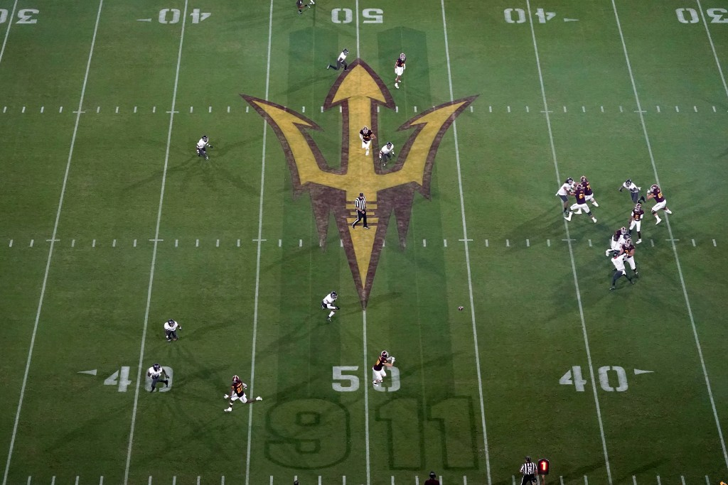 A Sept. 11 memorial is shown on the field during the first half of an NCAA college football game between UNLV and Arizona State, Saturday, Sept. 11, 2...