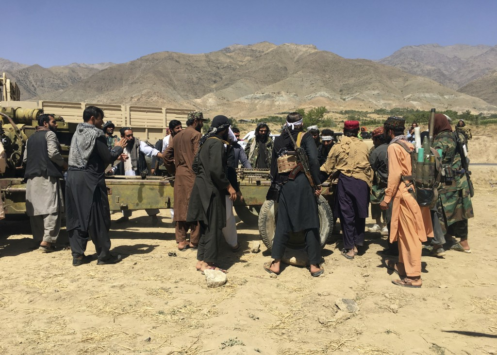 Taliban soldiers gather with weapons and machinery in Panjshir province northeastern of Afghanistan, Wednesday, Sept. 8, 2021. (AP Photo/Mohammad Asif...