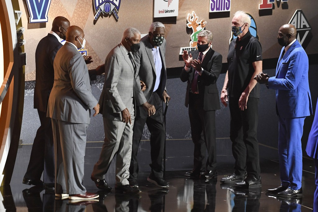 Inductee Bill Russell is escorted on stage by Julius Erving during the 2021 Basketball Hall of Fame Enshrinement ceremony, Saturday, Sept. 11, 2021, i...