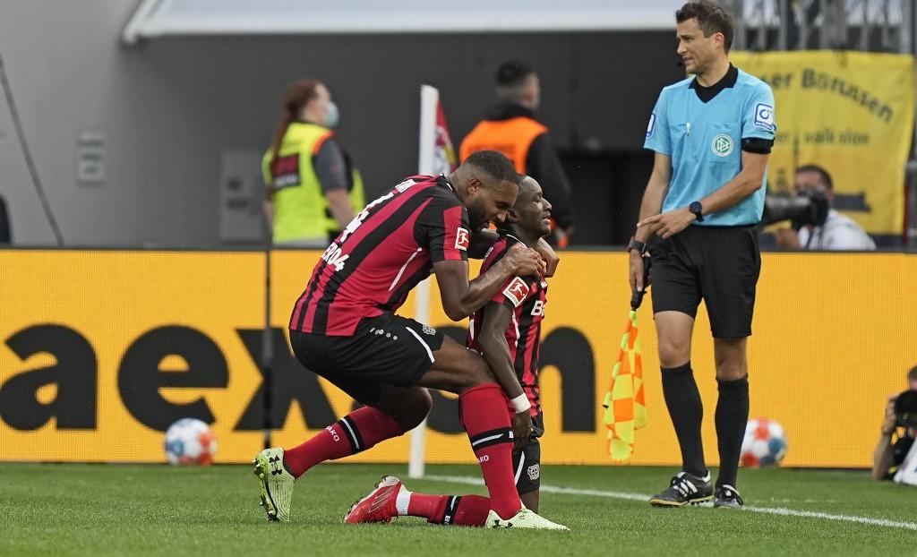 Leverkusen's scorer Moussa Diaby celebrates with Leverkusen's Jonathan Tah after he scored his side's third goal during the German Bundesliga soccer m...