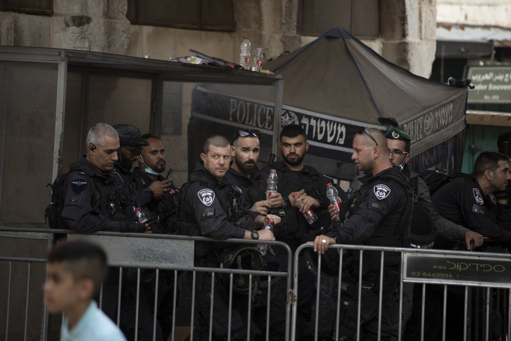 Israeli police stand guard at a checkpoint in the Old City of Jerusalem, Friday, Sept. 10, 2021. Amid increased Israeli-Palestinian tension over a rec...