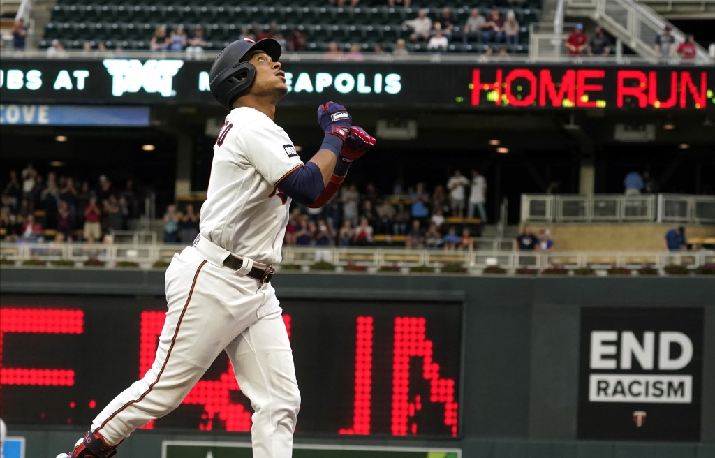 Minnesota Twins' Jorge Polanco jogs home on a solo home run off Kansas City Royals pitcher Brady Singer in the first inning of a baseball game, Saturd...