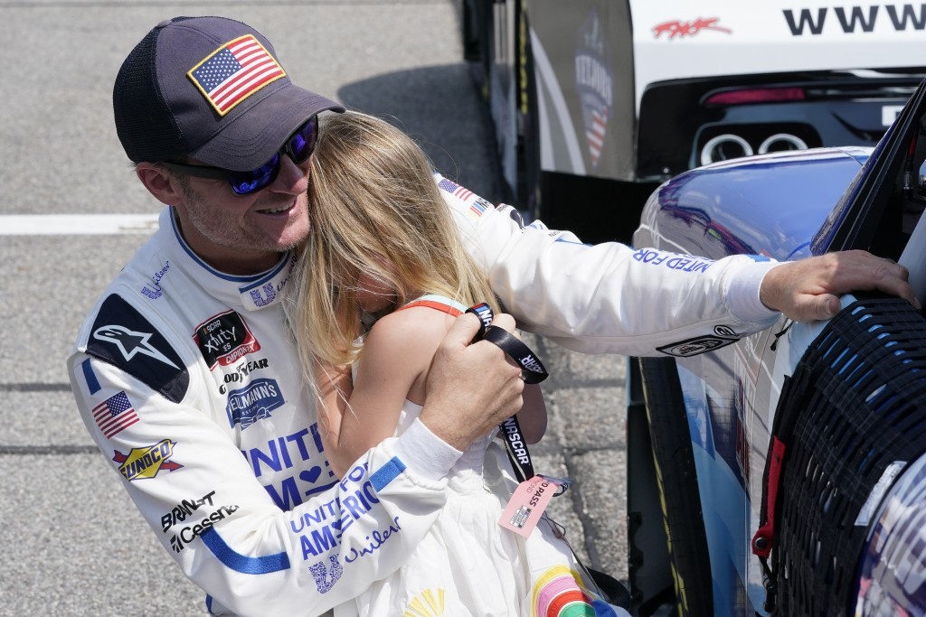 Dale Earnhardt Jr., comforts his daughter Isla, 3, during driver introductions prior to the start of the NASCAR Xfinity auto race in Richmond, Va., Sa...