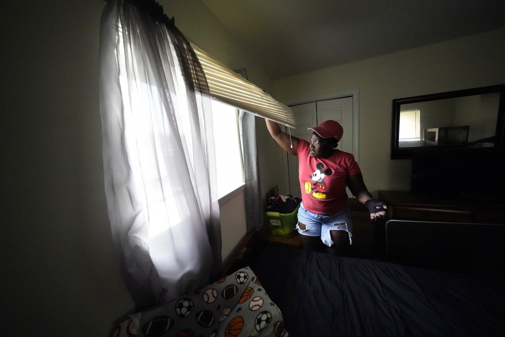 Natasha Blunt looks at the mold from Hurricane Ida in the window of her grandson's room, in Chalmette, La., Monday, Sept. 6, 2021. Before the hurrican...