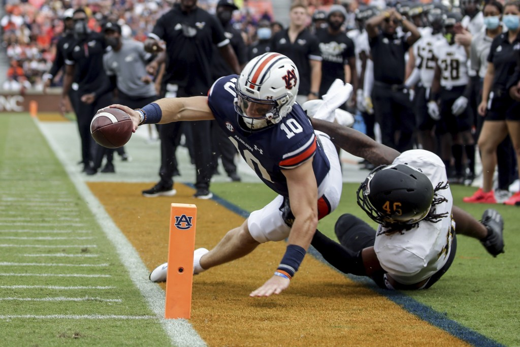 Auburn quarterback Bo Nix (10) comes up short as he stretches for the goal line as Alabama State linebacker Jake Howard (46) tackles him during the fi...