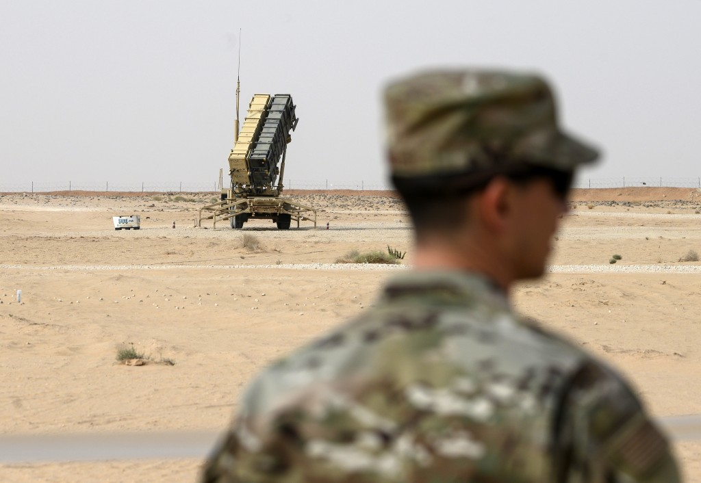 FILE - In this Feb. 20, 2020, file pool photo, a member of the U.S. Air Force stands near a Patriot missile battery at Prince Sultan Air Base in Saudi...
