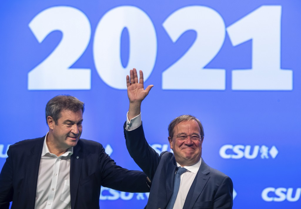 Markus Söder, left, CSU party leader and prime minister of Bavaria, and Armin Laschet, CDU/CSU candidate for chancellor, are on stage together at the ...
