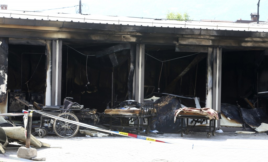 Destroyed hospital equipment is left outside the burned out makeshift hospital in North Macedonia's northwestern town of Tetovo, Saturday, Sept. 11, 2...