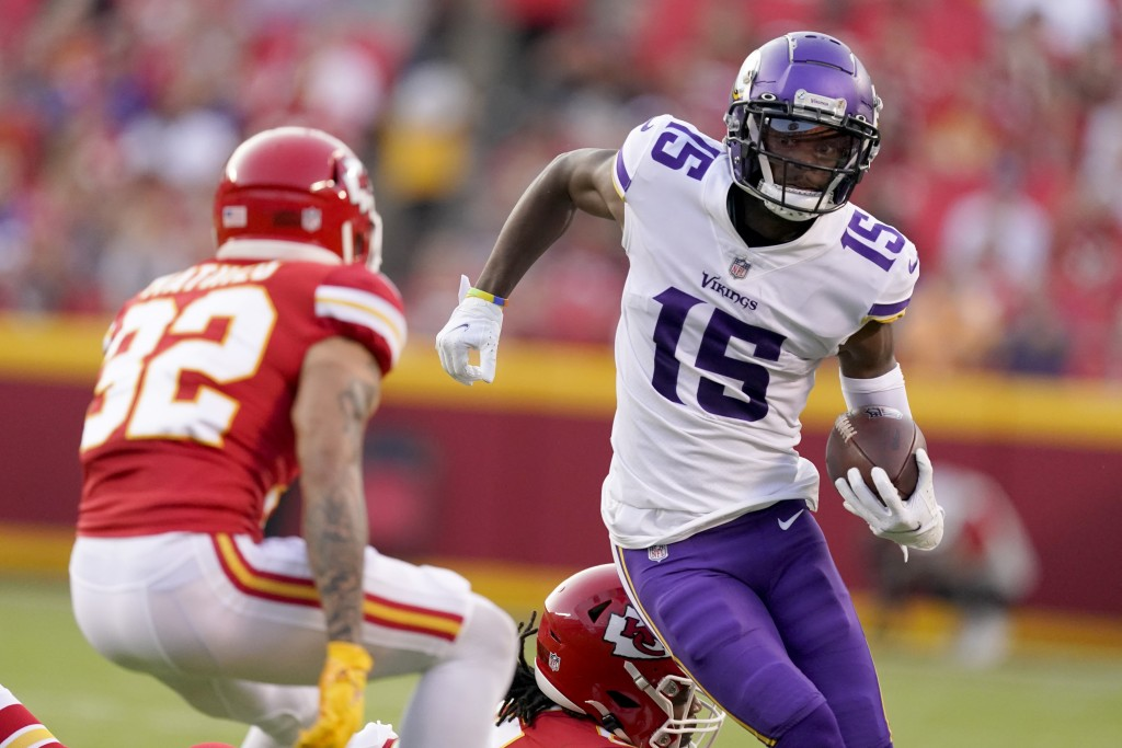 Minnesota Vikings wide receiver Ihmir Smith-Marsette (15) runs with the ball as Kansas City Chiefs safety Tyrann Mathieu (32) defends during the first...