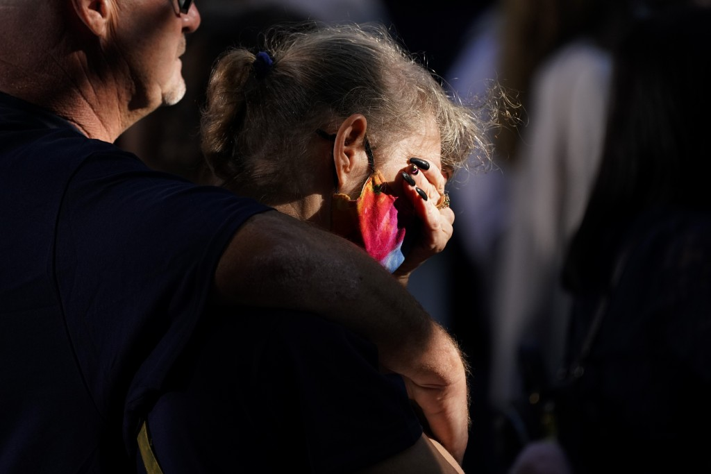 A person reacts as they attend a ceremony marking the 20th anniversary of the Sept. 11, 2001, terrorist attacks at the National September 11 Memorial ...