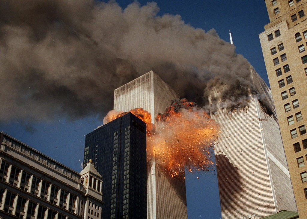 Smoke billows from one of the towers of the World Trade Center as flames and debris explode from the second tower, Tuesday, Sept. 11, 2001. (AP Photo/...