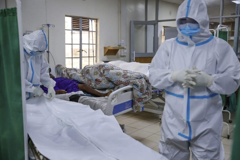 FILE - In this Friday, Aug. 20, 2021 file photo, medical workers prepare to remove the body of a coronavirus patient who had died, in the intensive ca...