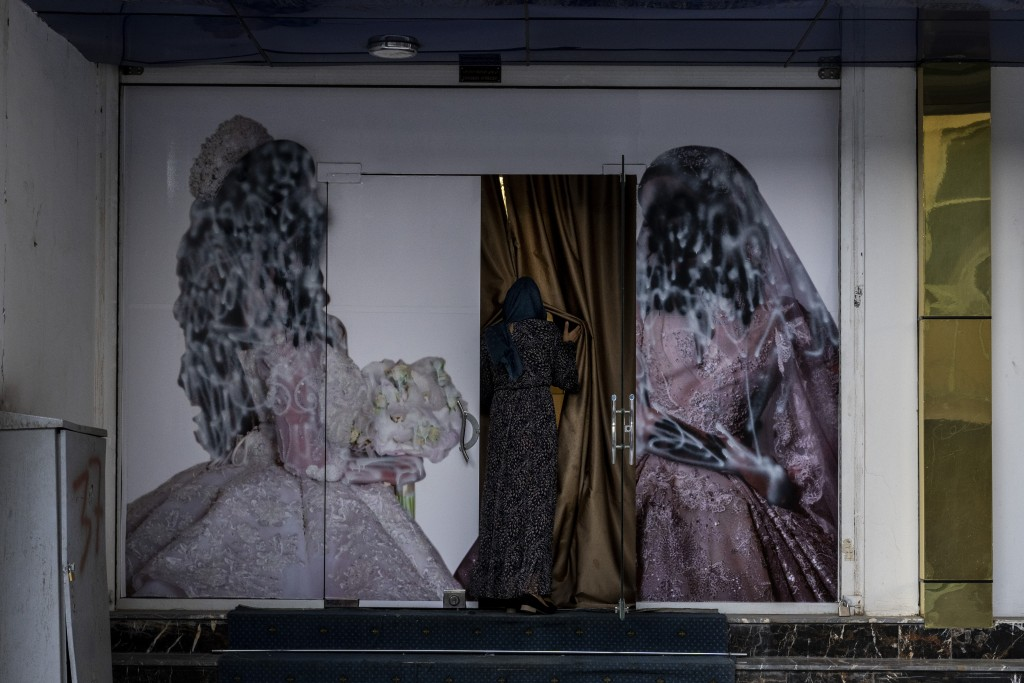 An Afghan woman enters a beauty salon in Kabul, Afghanistan, Saturday, Sept. 11, 2021. Since the Taliban gained control of Kabul, several images depic...