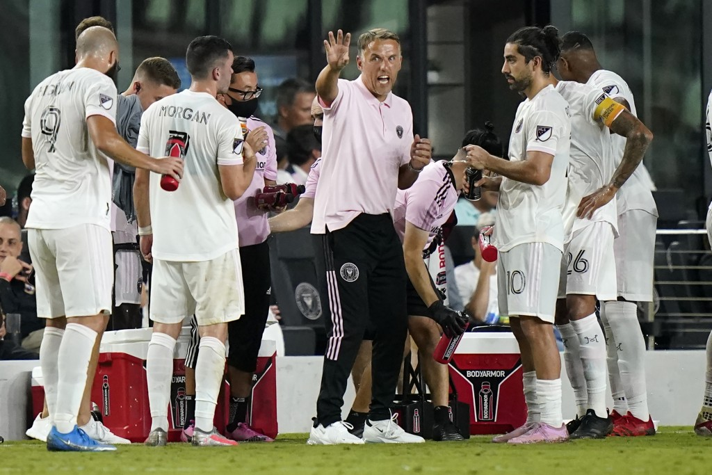 Inter Miami head coach Phil Neville, center, talks with midfielder Rodolfo Pizarro (10) during the second half of the team's MLS soccer match against ...