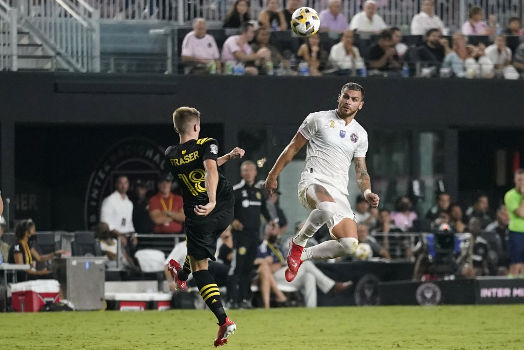 Inter Miami defender Leandro Gonzalez Pirez, right, heads the ball next to Columbus Crew midfielder Liam Fraser (18) during the second half of an MLS ...
