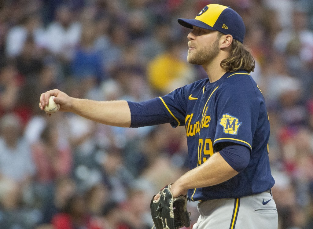Milwaukee Brewers starting pitcher Corbin Burnes stretches between batters during the fifth inning of a baseball game against the Cleveland Indians in...