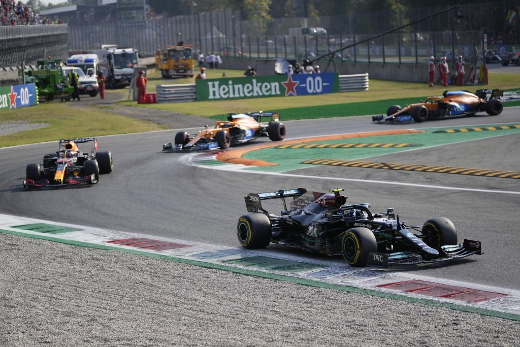 Mercedes driver Valtteri Bottas of Finland leads Red Bull driver Max Verstappen of the Netherlands and the two McLaren during the Sprint Race qualifyi...