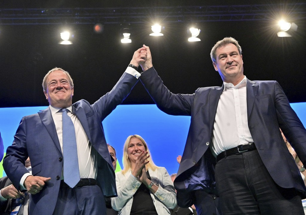 Markus Soeder, right, CSU party leader and prime minister of Bavaria, and Armin Laschet, CDU/CSU candidate for chancellor, stand together on stage aft...