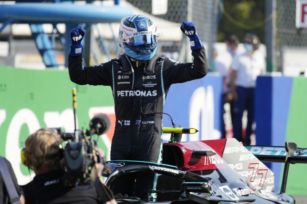 Mercedes driver Valtteri Bottas of Finland celebrates winning the Sprint Race qualifying session at the Monza racetrack, in Monza, Italy , Saturday, S...