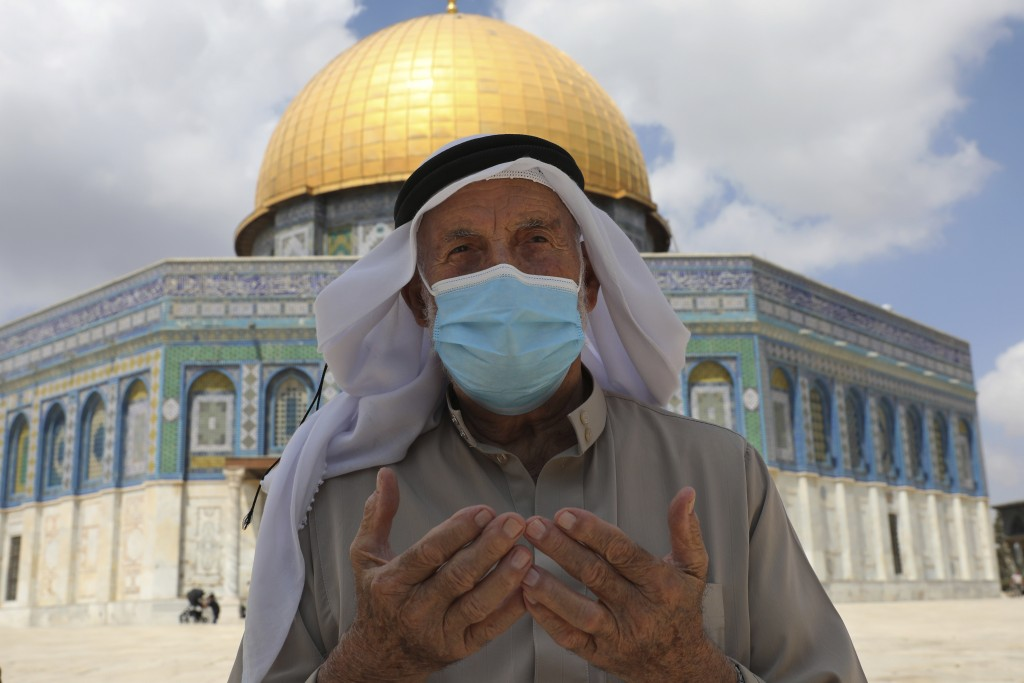 A Palestinian man prays at the Dome of the Rock Mosque in the Al Aqsa Mosque during Friday prayers before a protest celebrating the six Palestinian pr...