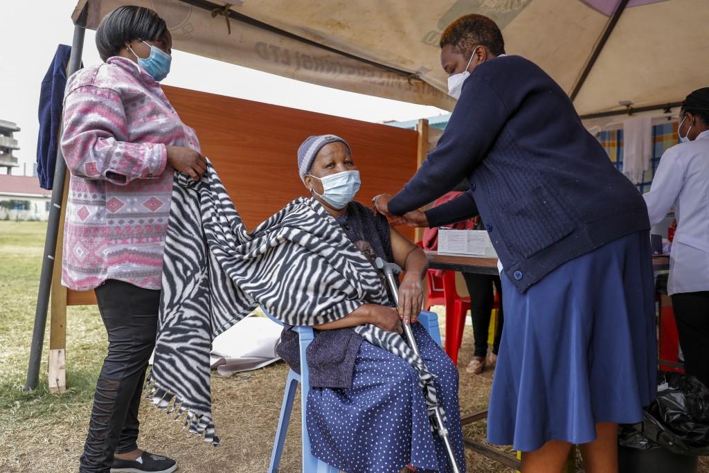 A Kenyan woman receives the AstraZeneca coronavirus vaccine at Kenyatta National Hospital in Nairobi, Kenya Thursday, Aug. 26, 2021. Wealthier nations...