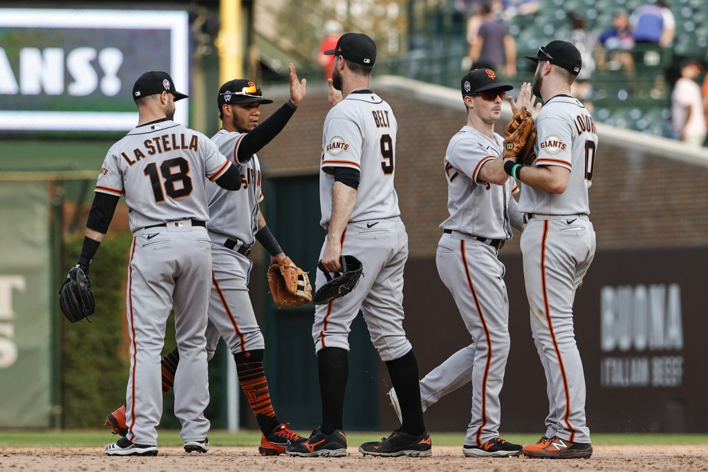 San Francisco Giants players celebrate the team's 15-4 win over the Chicago Cubs in a baseball game, Saturday, Sept. 11, 2021, in Chicago. (AP Photo/K...