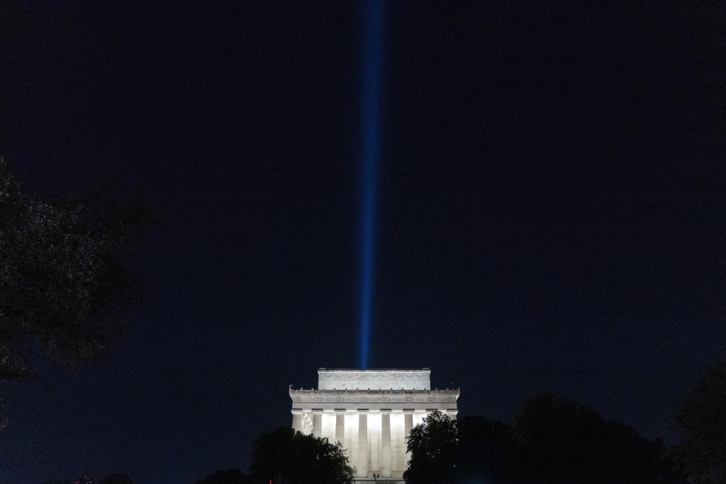 A beam of light is visible over the Lincoln Memorial, the day before the 20th anniversary of the Sept. 11 terrorist attacks, as part of the Towers of ...