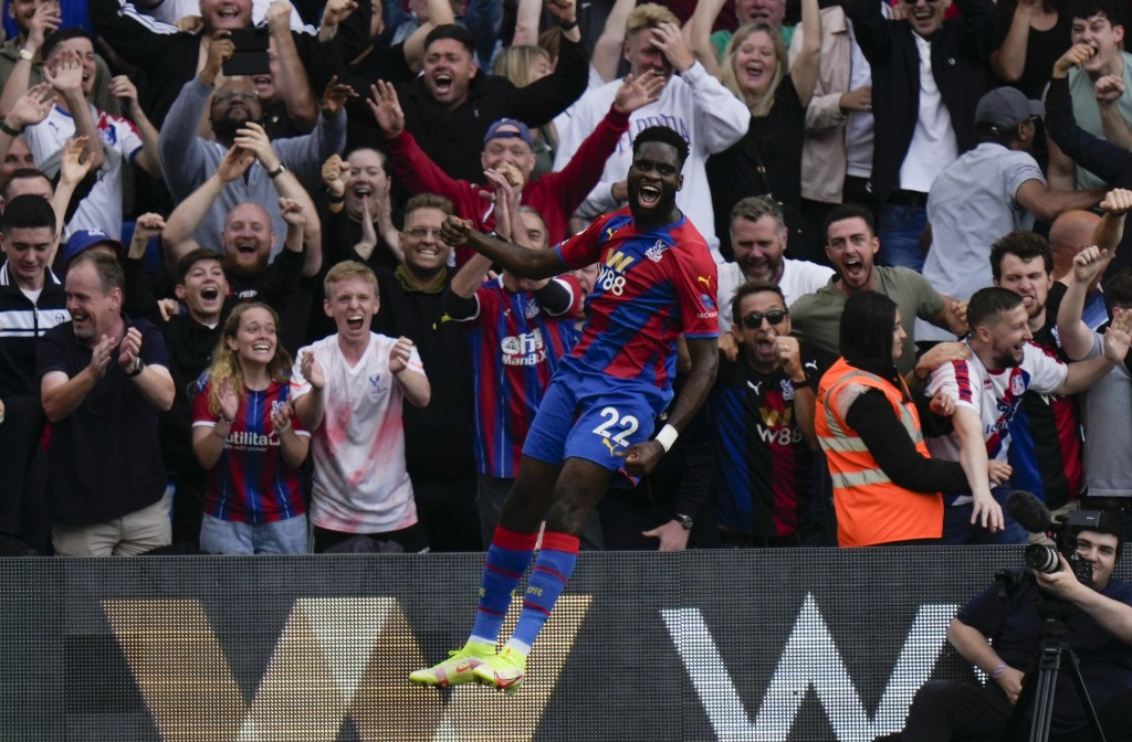 Crystal Palace's Odsonne Edouard celebrates after scoring his side's second goal challenge for the ball during the English Premier League soccer match...