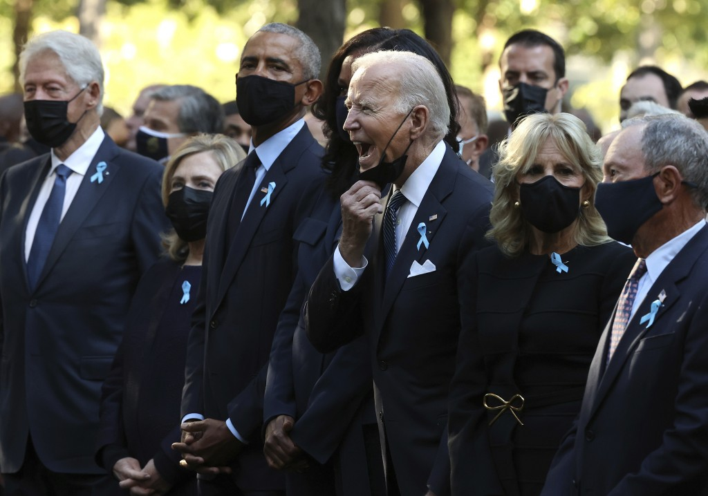 President Joe Biden, center, calls out as he is joined by, from left, former President Bill Clinton, former First Lady Hillary Clinton, former Preside...