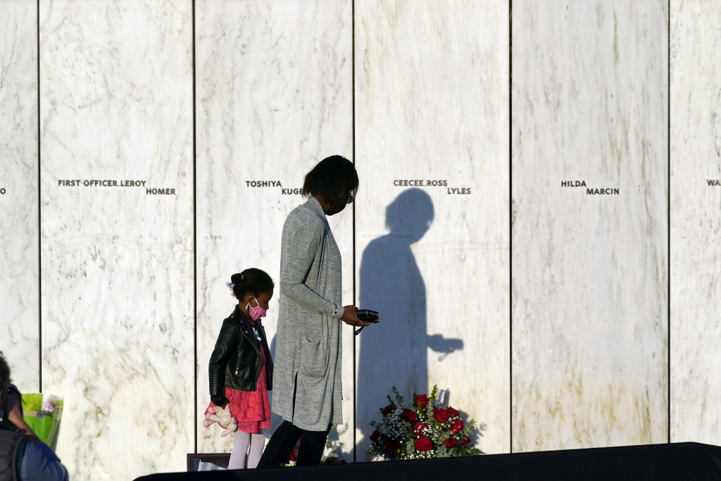 Family of Flight 93 first officer Leroy Homer walk along the Wall of Names at the Flight 93 National Memorial in Shanksville, Pa. before a Service of ...