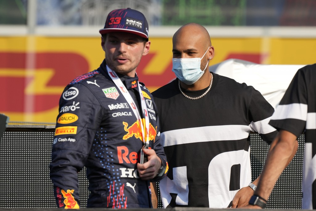 100 meters Olympic Champion Marcell Jacobs poses with second placed Red Bull driver Max Verstappen of the Netherlands after the Sprint qualifying at t...