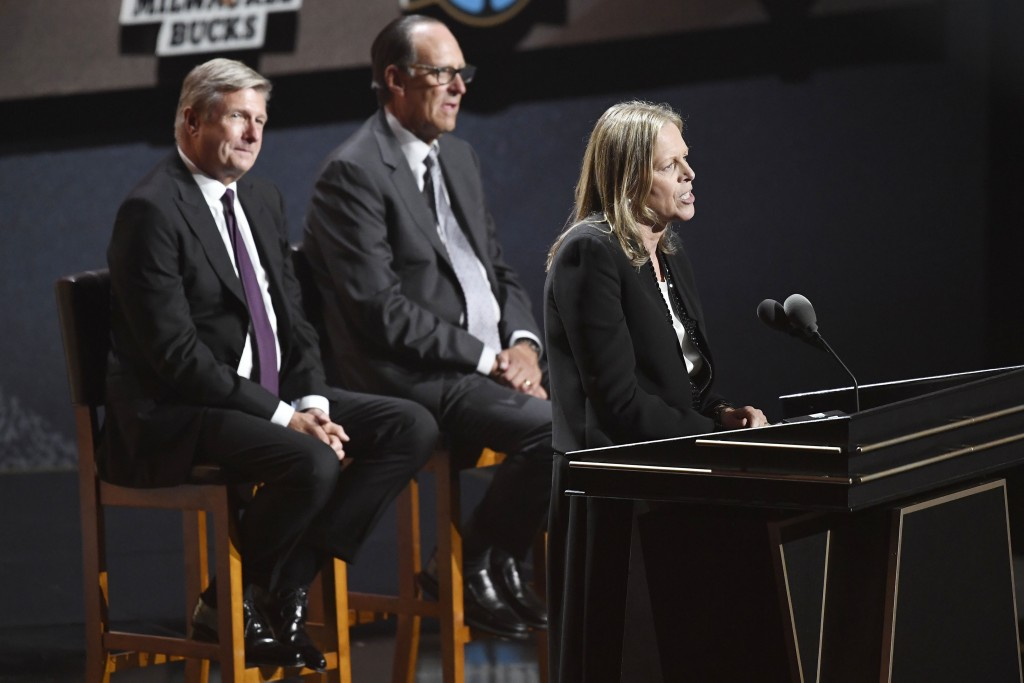 Inductee Val Ackerman, speaks as presenters Rick Welts, left, and Russ Granik listen during the 2021 Basketball Hall of Fame Enshrinement ceremony, Sa...
