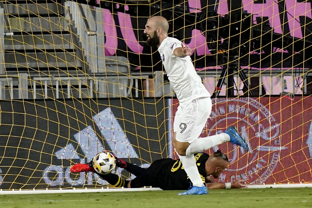 Inter Miami forward Gonzalo Higuain (9) celebrates after scoring a goal as Columbus Crew defender Vito Wormgoor falls to the field during the first ha...