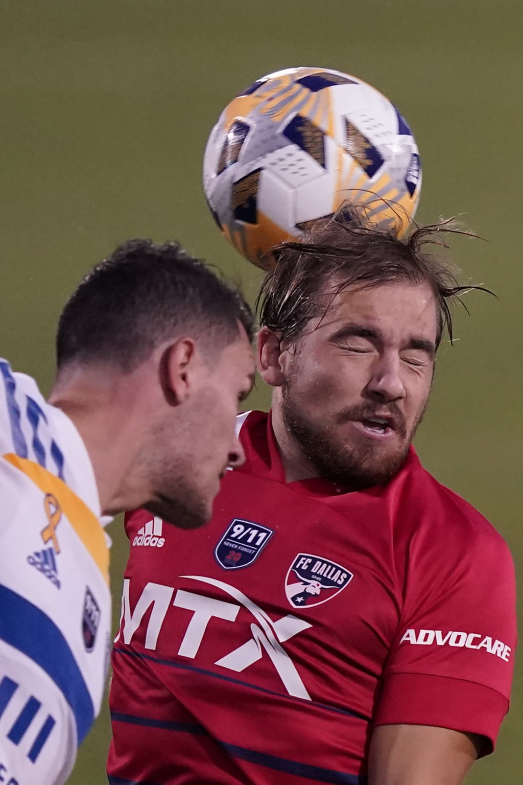 FC Dallas midfielder Paxton Pomykal, right, hits a header against San Jose Earthquakes defender Nathan, left, during the first half of an MLS soccer m...