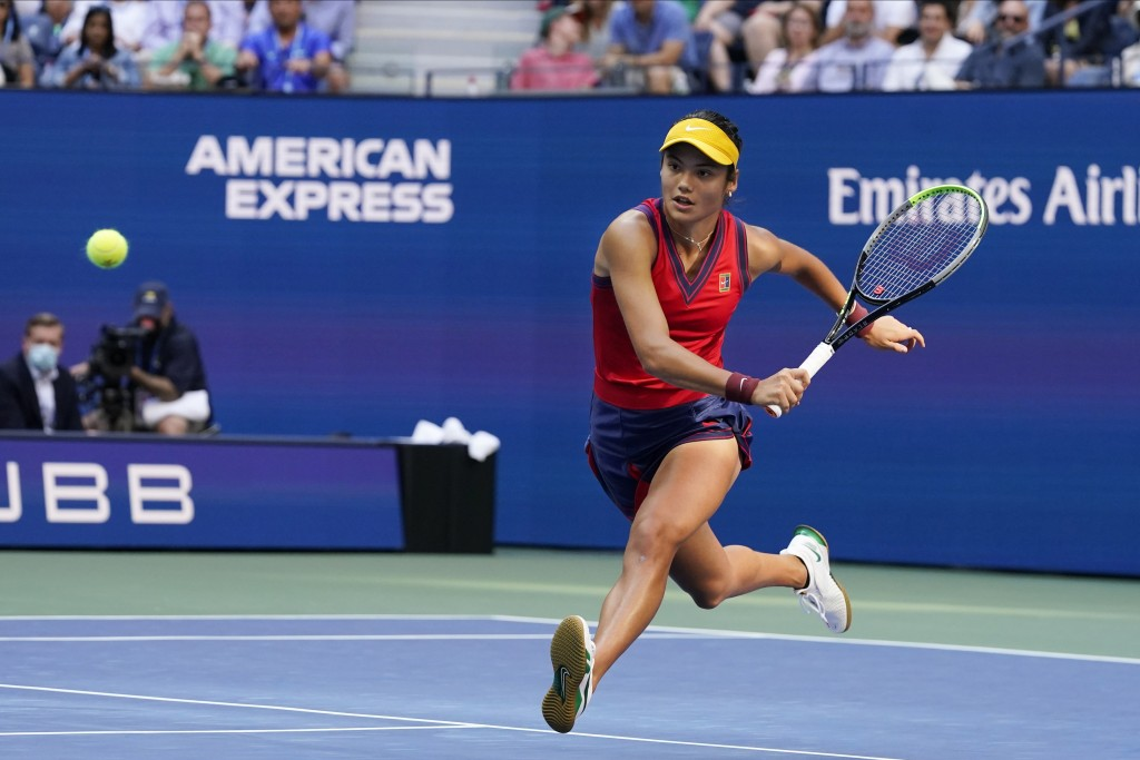 Emma Raducanu, of Britain, chases down a shot from Leylah Fernandez, of Canada, during the women's singles final of the US Open tennis championships, ...