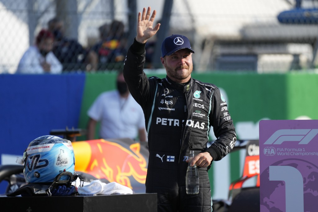Mercedes driver Valtteri Bottas of Finland waves to fans after winning the Sprint Race qualifying session at the Monza racetrack, in Monza, Italy , Sa...