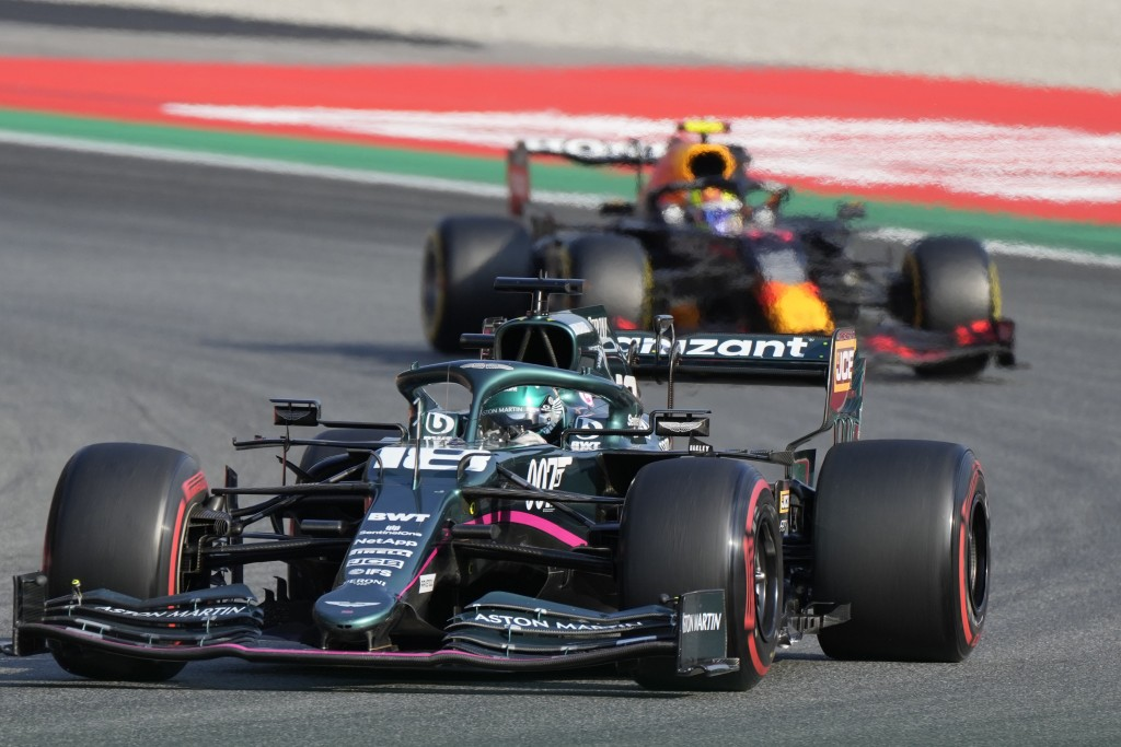 Mercedes driver Valtteri Bottas of Finland leads Red Bull driver Max Verstappen of the Netherlands during the Sprint Race qualifying session at the Mo...