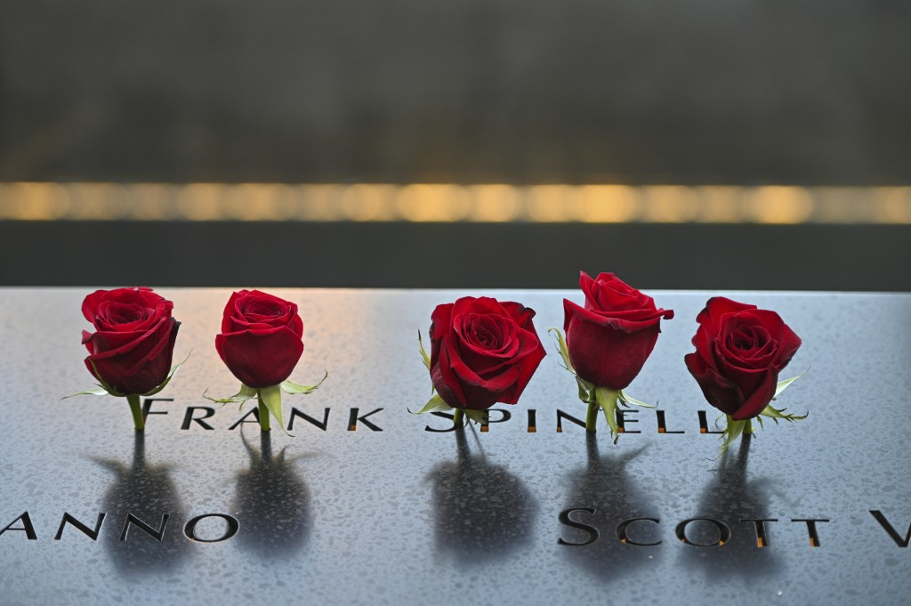 Flowers placed at the name of Frank Spinelli before ceremonies to commemorate the 20th anniversary of the Sept. 11 terrorist attacks, Saturday, Sept. ...