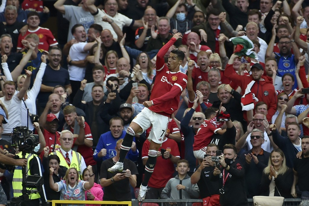 Manchester United's Cristiano Ronaldo celebrates after scoring his side's second goal during the English Premier League soccer match between Mancheste...