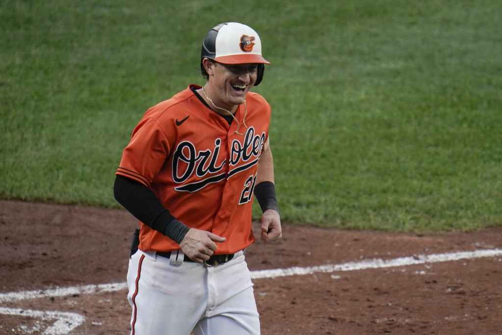 Baltimore Orioles' Austin Hays reacts after hitting a solo home run against the Toronto Blue Jays during the fourth inning of the first game of a base...