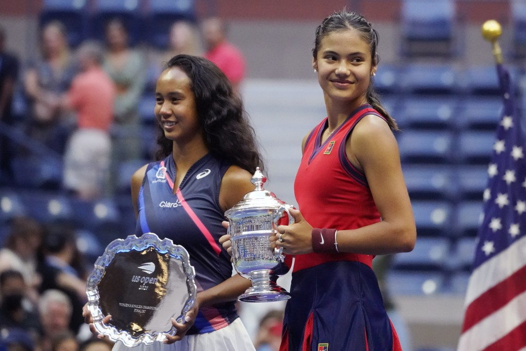 Emma Raducanu, of Britain, right, poses for photos with Leylah Fernandez, of Canada, after defeating Fernandez in the women's singles final of the US ...