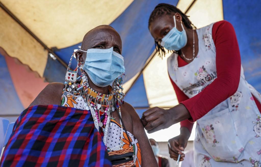 A Maasai woman receives the AstraZeneca coronavirus vaccine at a clinic in Kimana, southern Kenya Saturday, Aug. 28, 2021. Wealthier nations are awash...