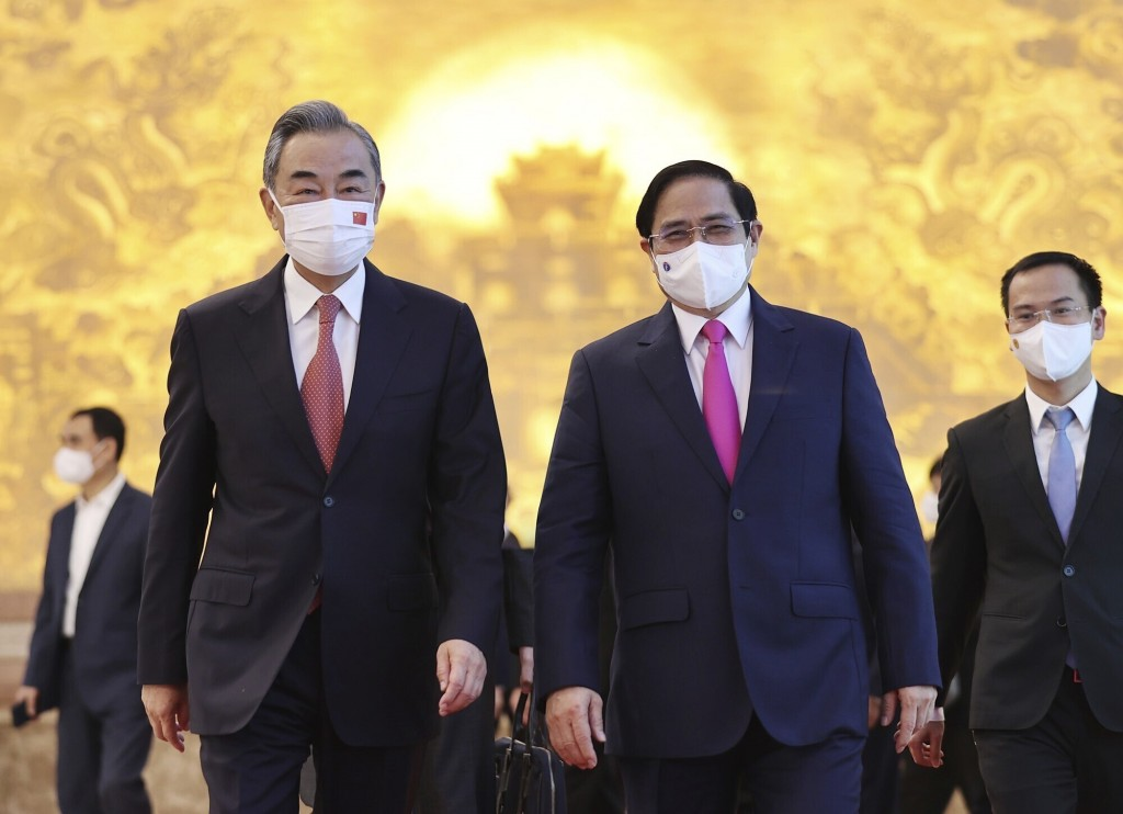 Vietnamese Prime Minister Pham Minh Chinh and Chinese Foreign Minister Wang Yi walk into meeting room in Hanoi, Vietnam on Saturday, Sep.11, 2021. Chi...