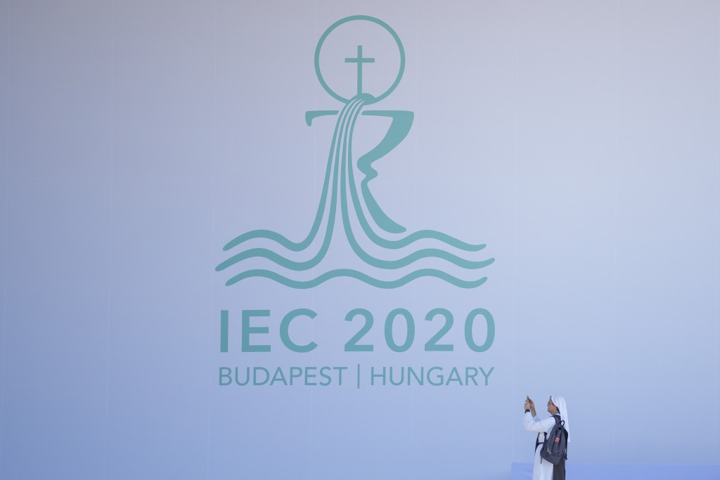 A nun takes a picture on the stage where Pope Francis will be celebrating mass, in Heroe's Square, Budapest, Hungary, Saturday, Sept. 11, 2021. Franci...