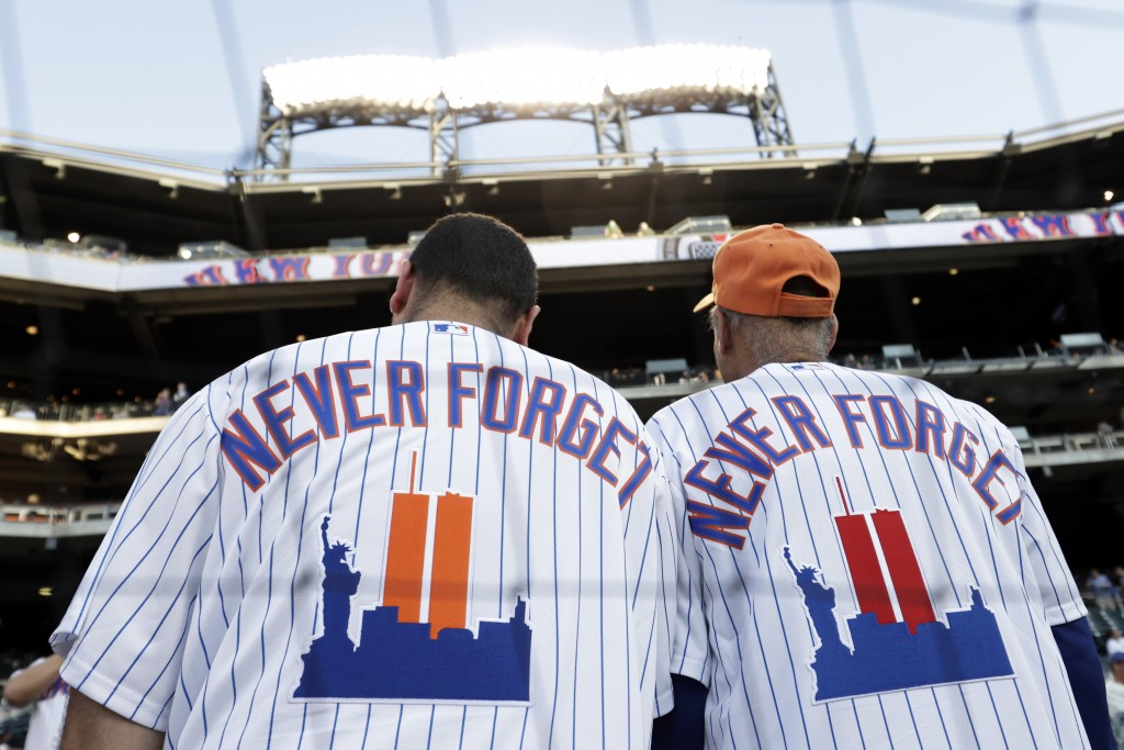 New York Mets fans wear jerseys to remember the 20th anniversary of the 9/11 terrorist attacks before a baseball game against the New York Yankees on ...