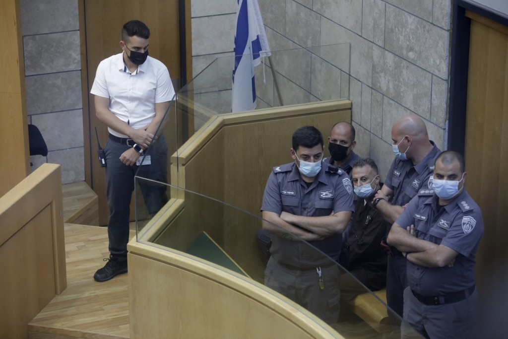 Yakub Kadari is surrounded by guards in a courtroom in Nazareth, Israel, after he and three other Palestinian fugitives were captured on Saturday, Sep...