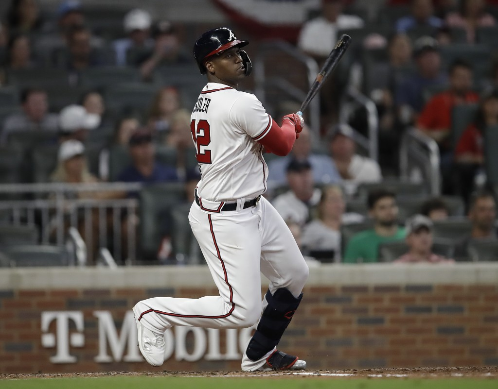 Atlanta Braves' Jorge Soler swings for an RBI double in the fifth inning of a baseball game against the Miami Marlins Saturday, Sept. 11, 2021, in Atl...