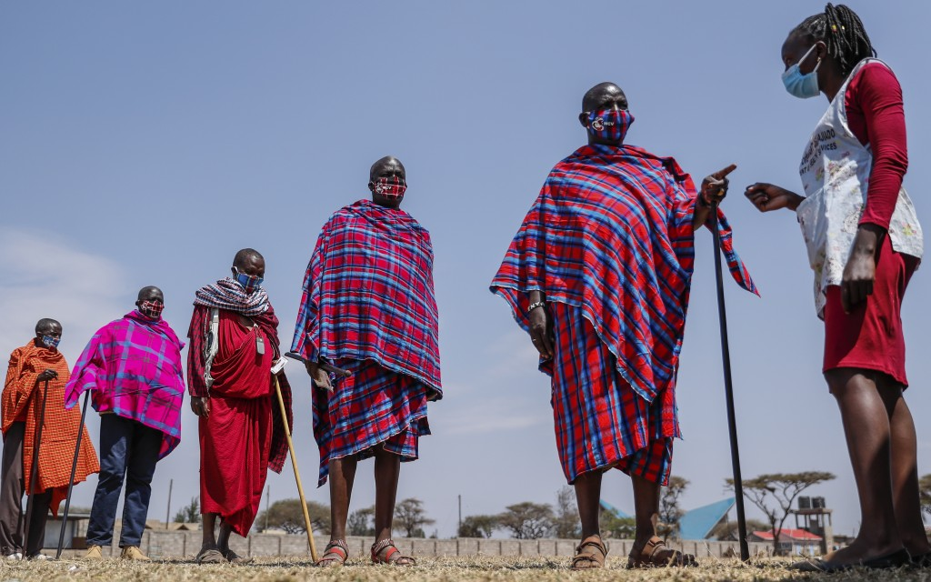 Maasai men queue to receive the AstraZeneca coronavirus vaccine at a clinic in Kimana, southern Kenya Saturday, Aug. 28, 2021. Wealthier nations are a...