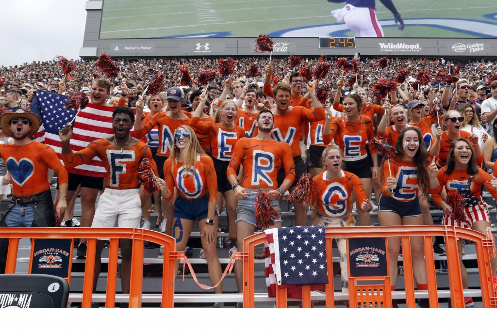 Auburn students use body paint to remember 9/11 during the first half of an NCAA football game against Alabama State Saturday, Sept. 11, 2021, in Aubu...