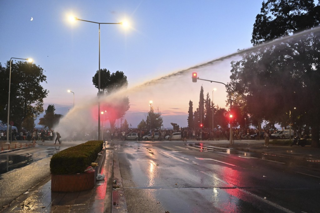 Greek police use a water cannon to disperse anti-vaccine protesters during a rally, at the northern city of Thessaloniki, Greece, Saturday, Sept. 11, ...